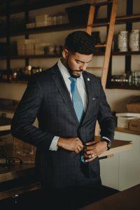 man in suite 200x300 - Communication Through Dress
