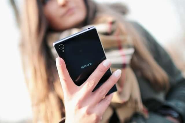 person woman hand smartphone 3 - Best Smartphones that Aren't Apple or Samsung