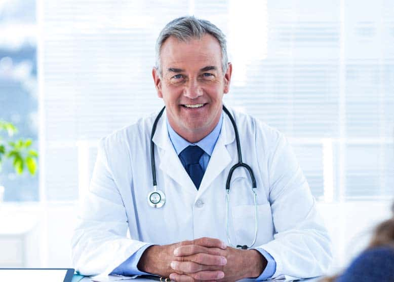smiling doctor - Different Types of Treatment For Prostate Cancer