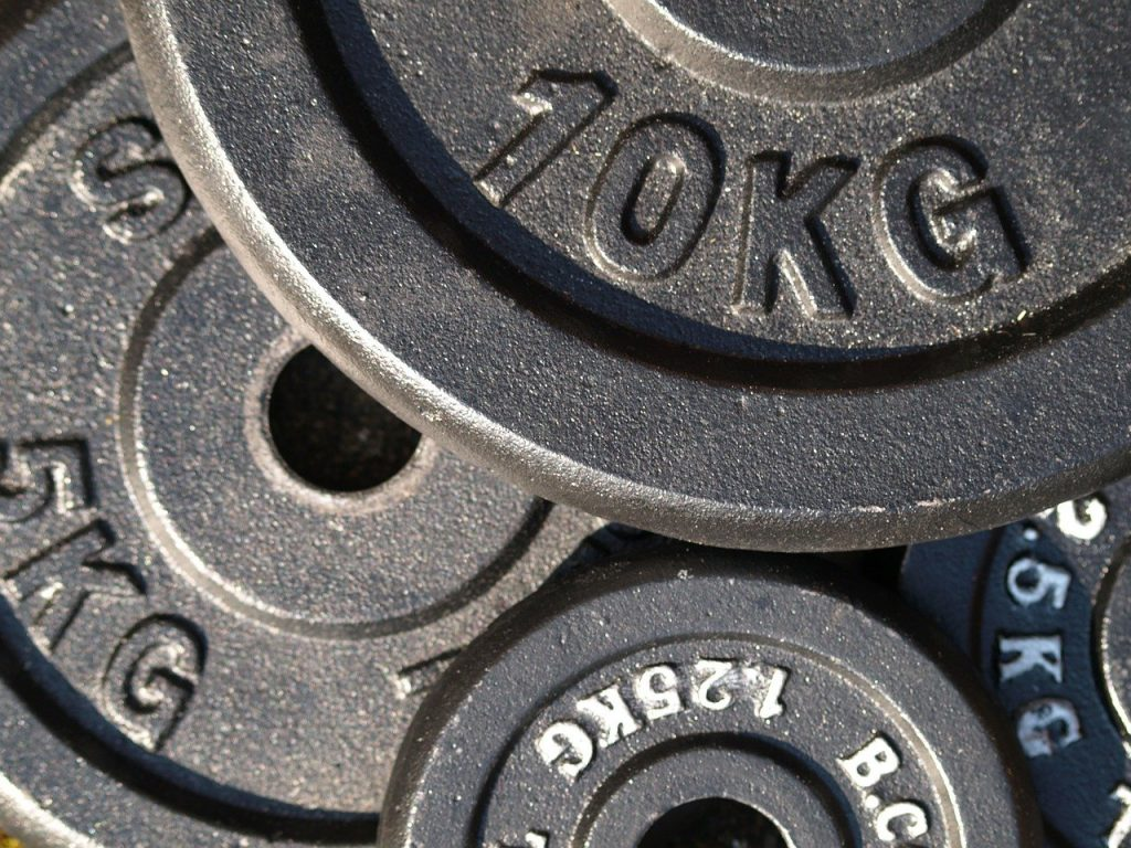 weight plates 299537 1280 1024x768 - Top 5 Equipment For Setting Up A Basic Home Gym