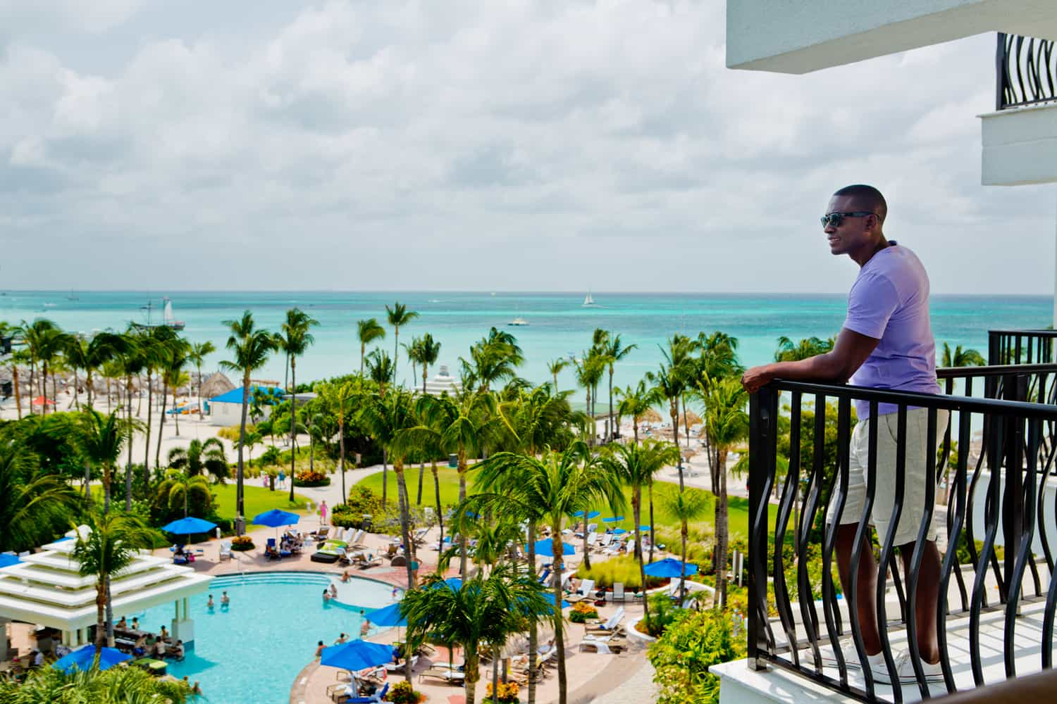 Aruba Marriott Resort  Man on Balcony - 30+ Unique Gifts For Men: 2017 Holiday Gift Guide