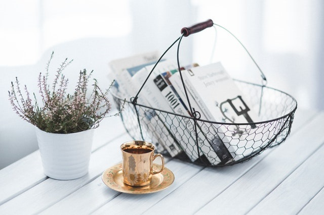 coffee cup books home - Personal Finance Books You Should Read in 2018