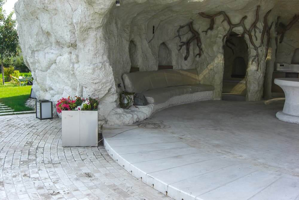 Man-made grotto as sunshade and architectural highlight in landscape design.