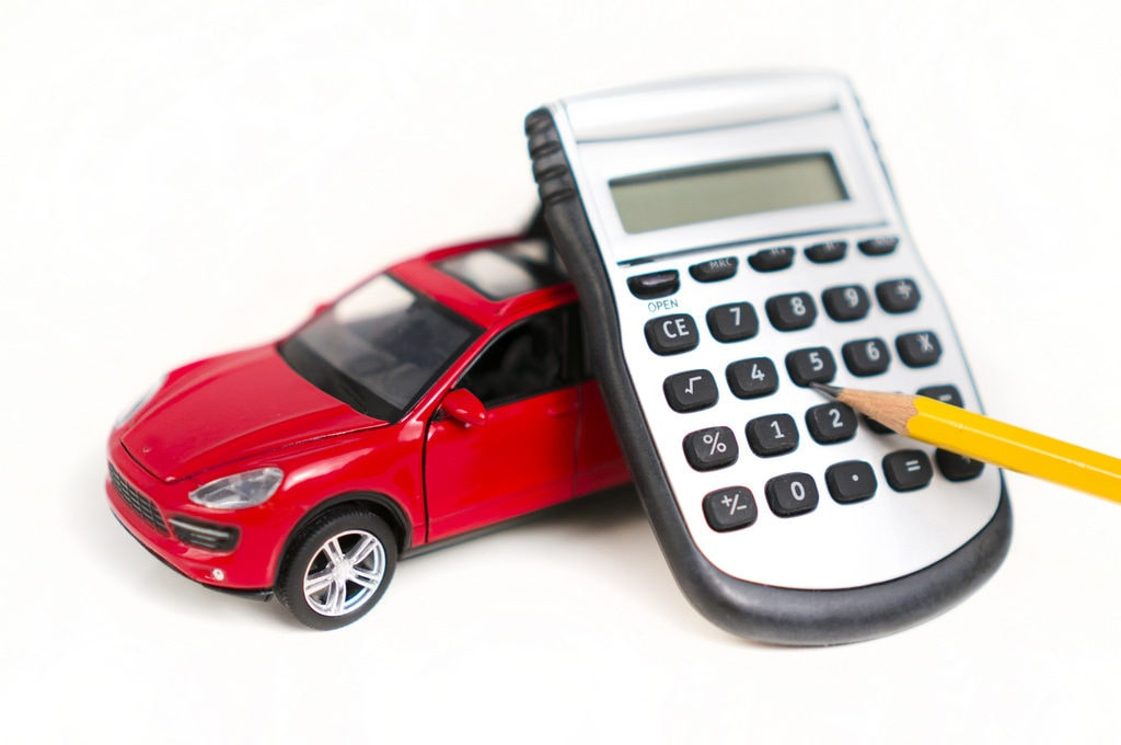 calculating tax for the car purchase 1024x680 - The Extra Steps of Buying a Car