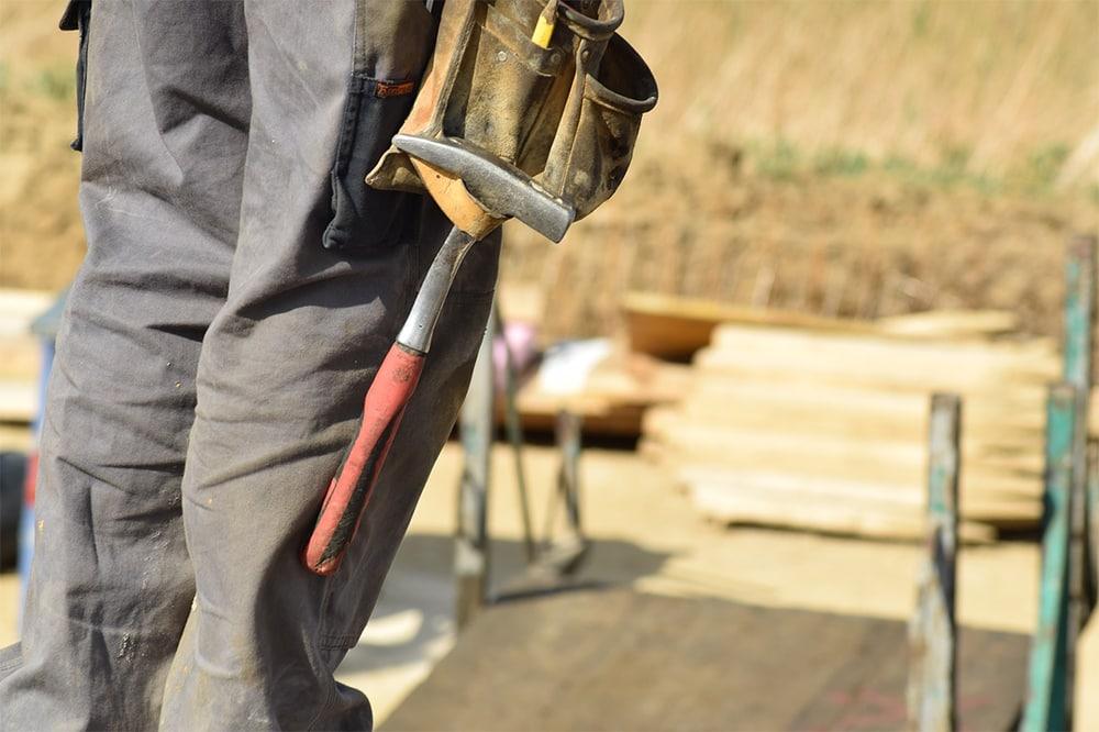 gentlemen doing house repairing - Four DIY skills that every gentleman homeowner should have