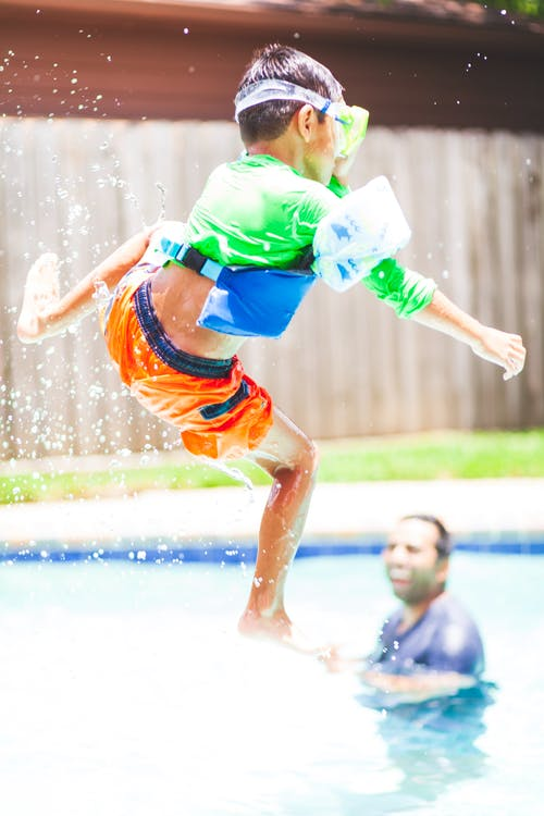 kid jumping to pool - How To Affordably Search For An Apartment