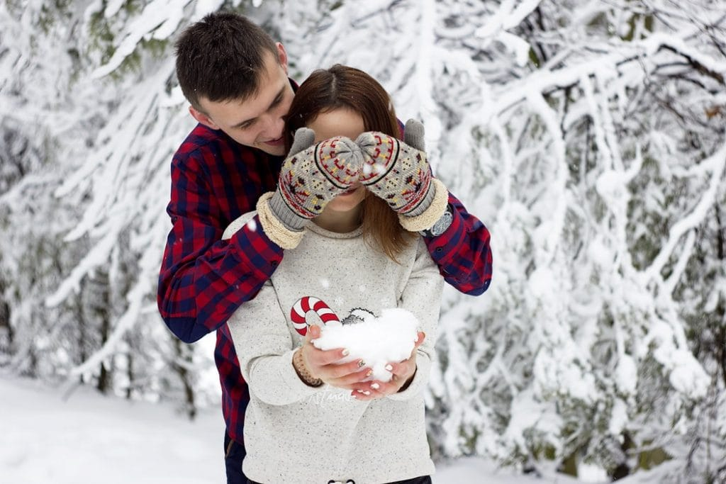 couples playing in snow 1024x683 - Tips For Men On Becoming The Lover Every Girl Wants