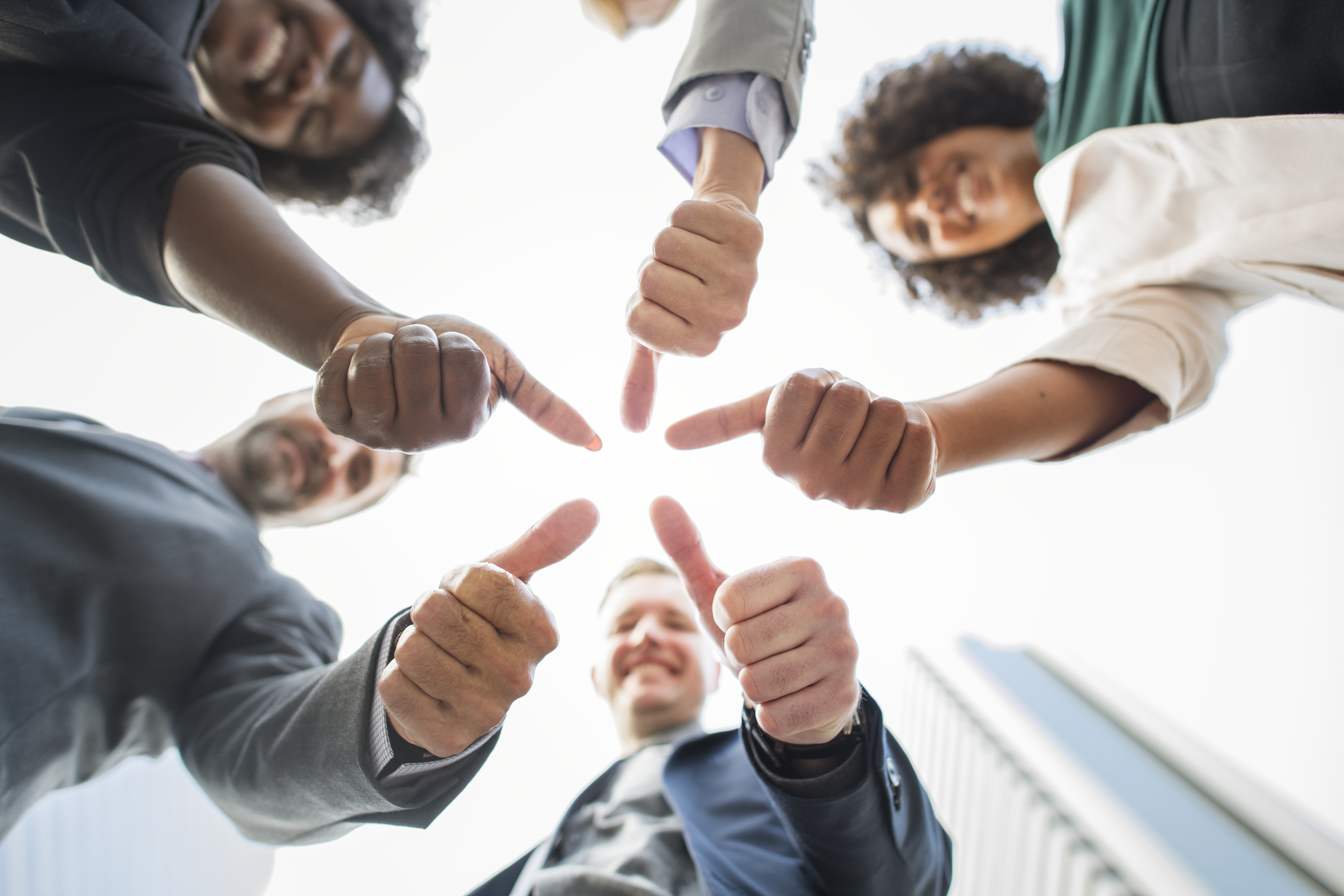 Business people giving a thumbs up