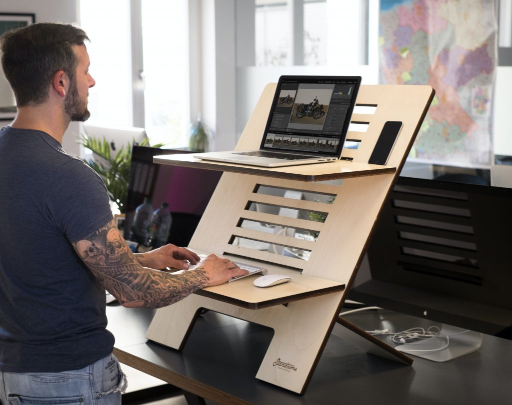 standing desk 1024x811 - Is Sitting During Work All the Time Actually That Bad?