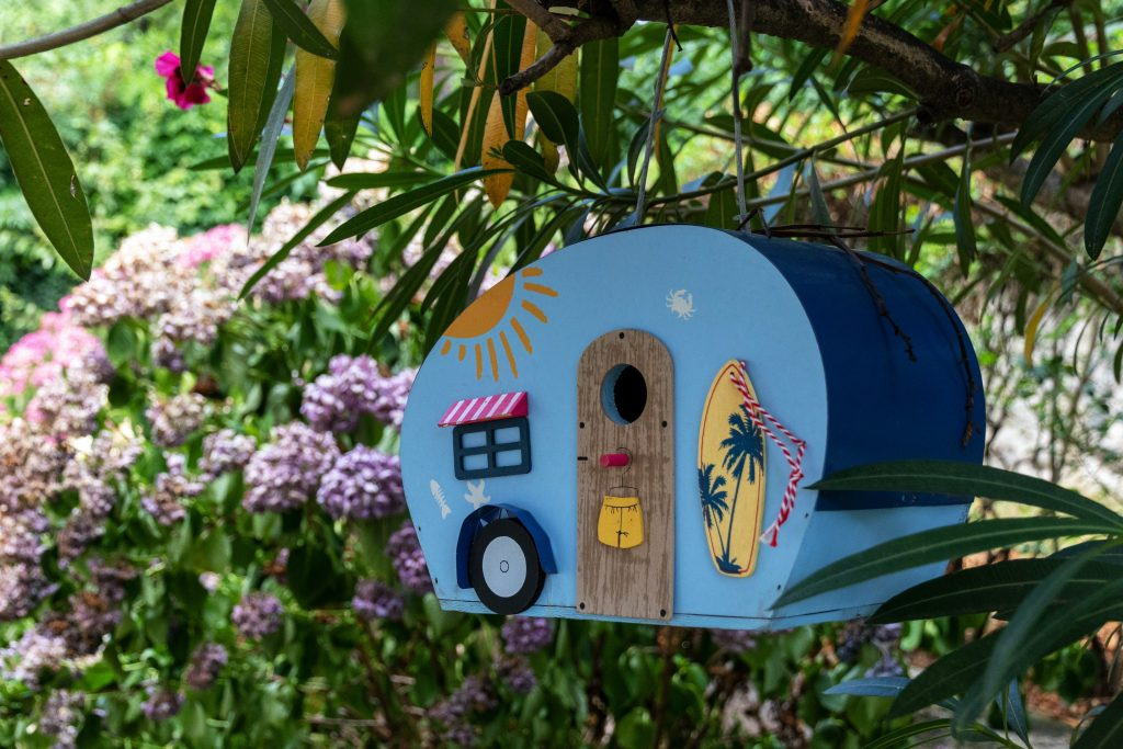 birdhouse and a bird feeder 1024x683 - Landscaping Ideas That Will Make Your Home Breathtaking