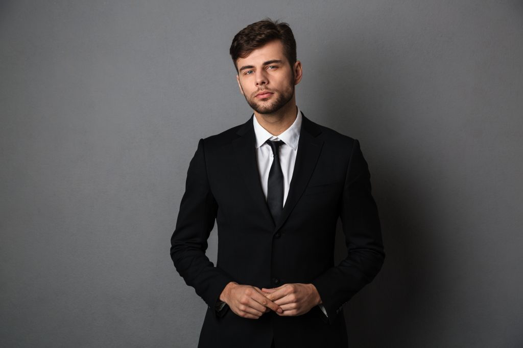 close up photo young successful business man black suit 1024x683 - The 9 Clothing Items Every Professional Should Own.