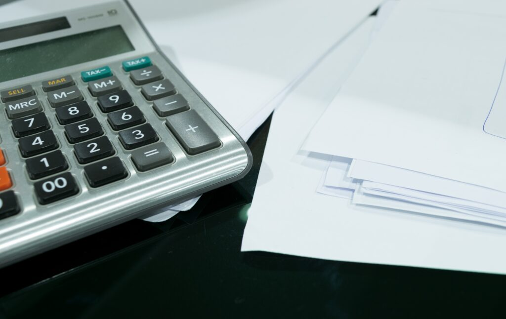 accounting documents and calculator 1024x646 - Money Management Tips for New Business Owners