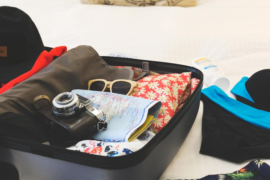 holiday suitcase - How to Plan Your Budget While Traveling Abroad
