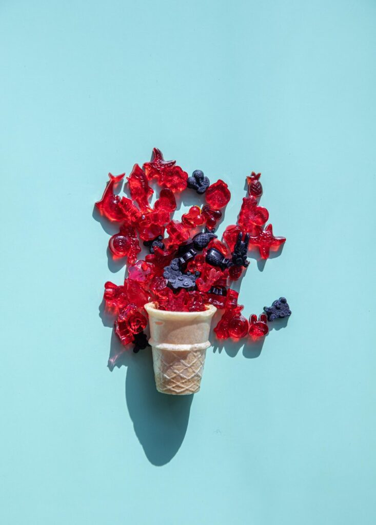 icecream cone with candy spilling out on blue background 733x1024 - Why Every Modern Gentleman Should Consider Adding CBD to Their Wellness Regime