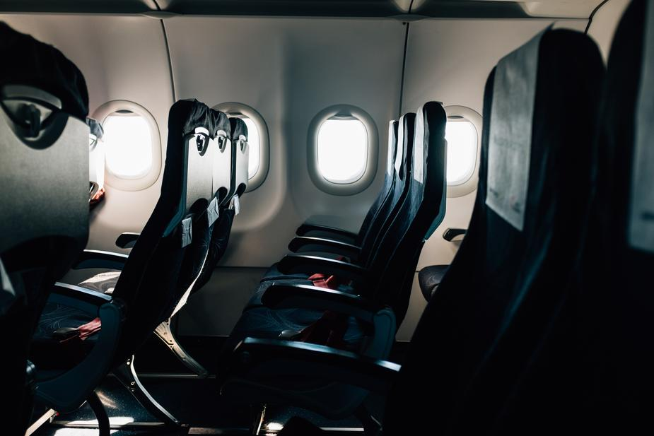 empty black seats on a commercial airplane - How to Choose a Business Credit Card