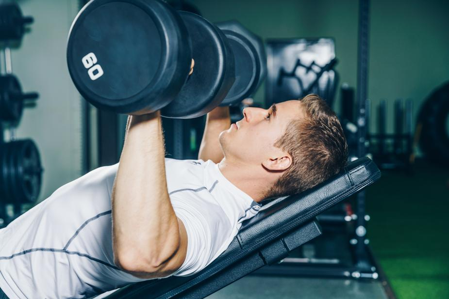 man lifting weights - How to Look Your Best in Your 40s