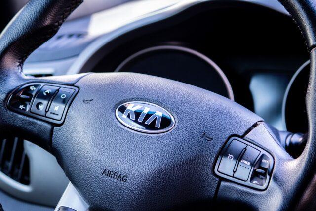 The Kia logo on a car
