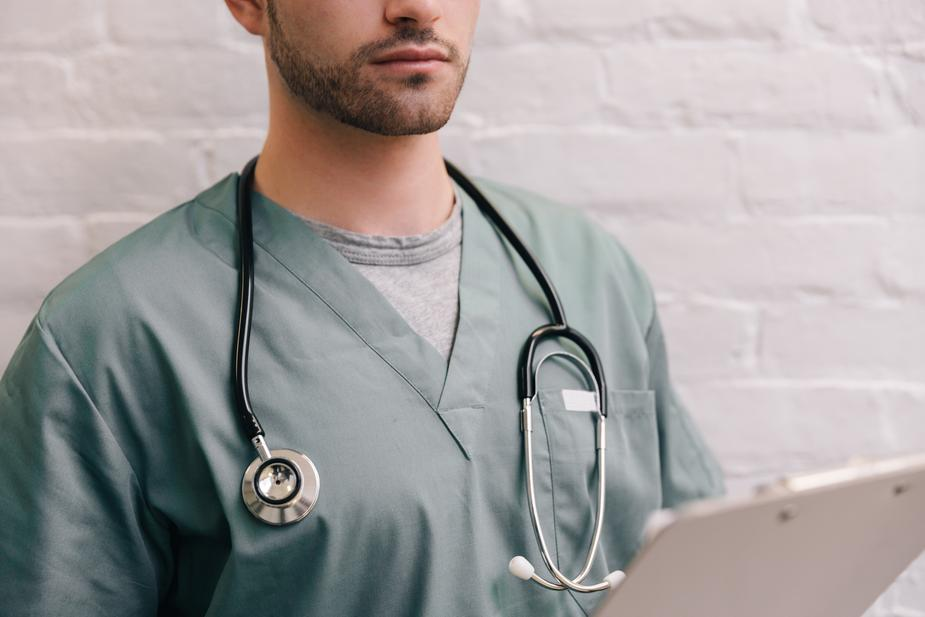 male doctor with stethoscope and clipboard - Ways to Overcome Erectile Dysfunction